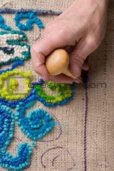 Mat making: hooking a rug