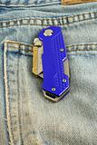 Blue anodized contractors razor knife on jeans pocket