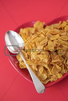 Cornflakes on a heart shaped plate