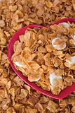 Cornflakes & sliced banana on a heart shaped plate