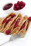 Pancakes with raspberry jam & fresh raspberries