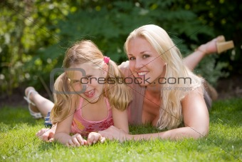 Mother and daughter in the grass