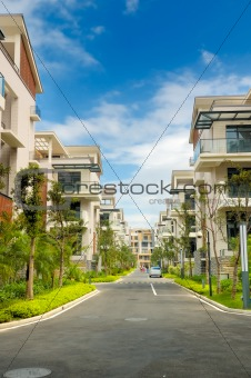 A road and two rows of new terrace houses