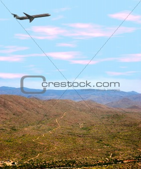 Airplane Over Desert