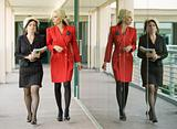 Modern Businesswomen on an Outdoor Walkway