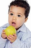 Small baby eating an apple