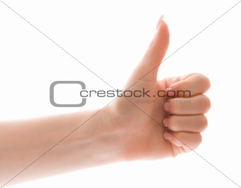 Thumb up gesture over white