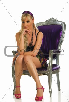 Beautiful young girl in the chair with fashionable sexy look