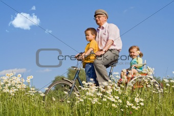 Riding with grandpa on a bike