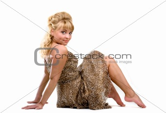 Sitting girl in a leopard dress