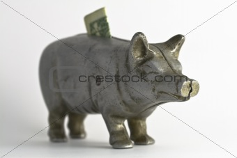 Old Piggy Bank with Dollar Bill