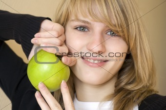 Portrait of girl with green apple