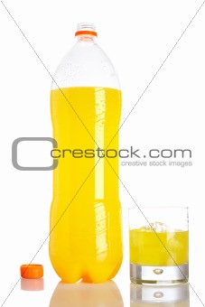 Bottle and glass of orange soda with droplets