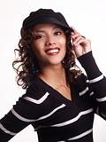 Pretty young hispanic woman with hand to hat