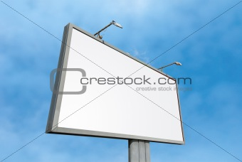 Blank billboard at cloudy sky