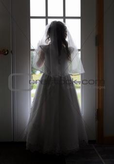 bridesmaid girl at window