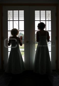 bridesmaids at window