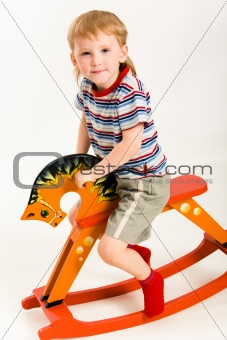 Boy on toy horse