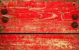 Red chipped paint on wood. Grunge background