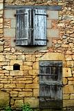 The closed windows, doors and shutters in an old wall (2)