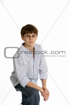 casual boy with arm resting on knee