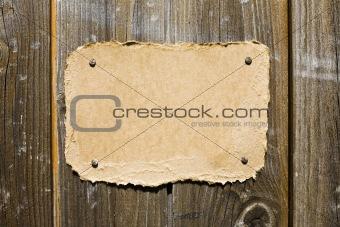 Torn Cardboard On Wooden Wall