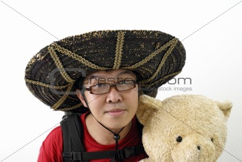 Asian tourist with teddy bear