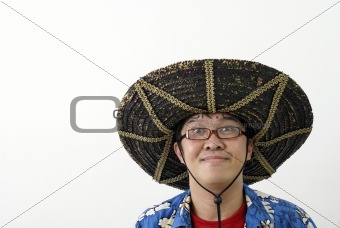 Asian man with mexican hat Asian man with mexican hat