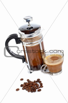 Cup and coffee pot with beans