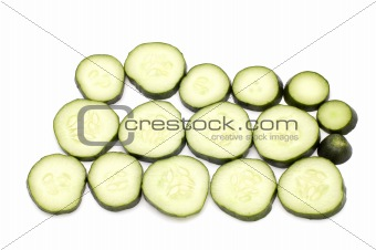 cutting cucumber on white