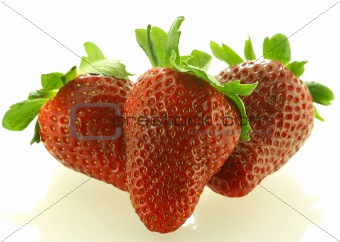 Close up shot of three ripe strawberry