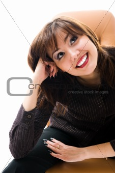 A young japanese woman smile. Sitting in an office armchair.