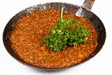 a pan full of sauce bolognaise