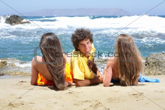 three happy teenagers on the beach