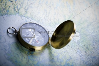 Old-fashioned compass on map