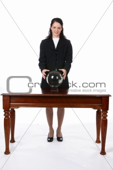 business woman with her hands on a crystal ball.
