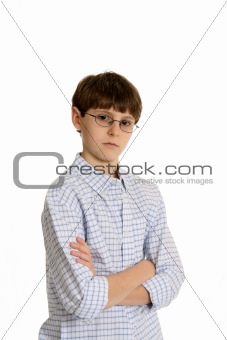 Boy with glasses and arms crossed
