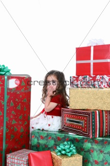 Little girl in holiday dress and presents