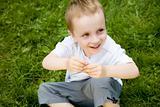 Child Sitting On The Grass