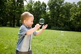 Little Boy Catch Soap Bubbles