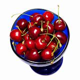 ripe sweet cherries in blue cup