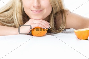 Portrait of young woman with two orange