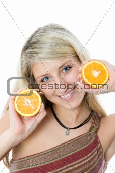 Beautiful girl with two slice juicy orange