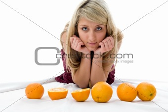 Beautiful girl thinks of oranges