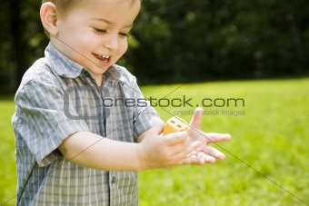 Baby Boy Playing Outdoors