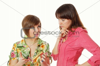 One girl giving an advice about cosmetic to another