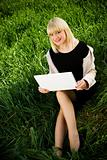 on the grass with laptop
