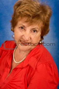 Portrait of attractive senior woman in red blouse