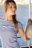 Beautiful young woman on a boat trip