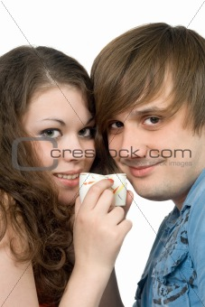 Portrait of young couple with glasses in hands. Isolated